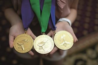 Hands holding medals