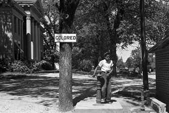 A boy at a segregated drinking fountain on the county courthouse lawn in Halifax, North Carolina in April 1938